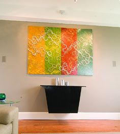 What a great idea. A painting that covers the TV when not in use.