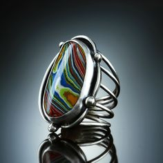 Fordite Ring. Fabricated Sterling Silver. www.amybuettner.com https://www.facebook.com/pages/Metalsmiths-Amy-Buettner-Tucker-Glasow/101876779907812?ref=hl