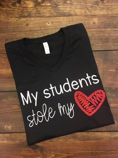 ~~My Students Stole My Heart~~ This design is done on a regular unisex fit Bella short sleeve t-shirt. The color menu is for shirt color. The design will be white. The heart is red glitter. You may choose from crew neck or v-neck styles.