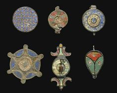 SIX ROMAN ENAMEL BROOCHES AND SEAL BOXES CIRCA 1ST-3RD CENTURY A.D.