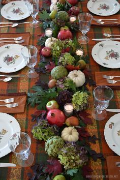 Fall table with natural table runner using hydrangeas, artichokes, leaves, pomegranates, pears, white pumpkins, apples and votives | homeiswheretheboatis.net