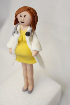 Fondant Pregnant Girl Cake Topper, via Etsy.