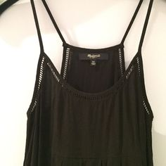 Madewell Black Racer Back Tank Adorable black top with cutout detail all around the neckline! Racer back style back. Light, flowy black fabric with spaghetti straps. Size: XS. Runs true to size. Worn once, great condition. No signs of wear. Would make a great addition to any summer closer! Throw on with jean shorts and you're ready! Madewell Tops Blouses