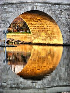 Reflection: I liked this photo because the light coming though the tunnel reflected on the water. Because the tunnel is a semi-circle, the tunnel and it's reflection created a circular shape, which I found very interesting. Beautiful World, Beautiful Images, Creative Photography, Art Photography, Symmetry Photography, Surrealism Photography, Digital Foto, Reflection Photography, Water Reflections