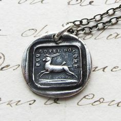 "Pictured is a running stag with an arrow in his hind quarter, surrounded by the Italian caption ""fu s go pel dolore"" (I Escape from the Pain), meaning I will endure and go on. Taken from the English proverb Pride Feels No Pain.   This charm signifies a loss in love or life, but not in pride and spirit....endure and move forward."