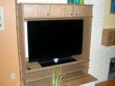 Carter builds a semi-recessed entertainment center for a family room. - Trend Home Entertainment 2020 Pallet Entertainment Centers, Floating Entertainment Center, Entertainment Ideas, Barn Door Console, Barn Doors, Television Cabinet, Cabinet Plans, Planer, Family Room