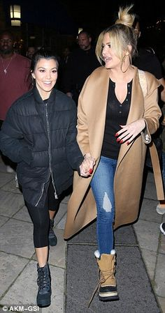 Sisterly love: Kourtney and Khloe held hands while walking to the alley