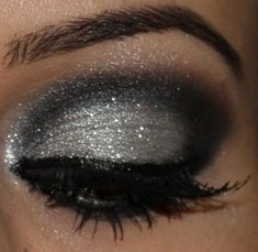 silver and black smokey eye...love love love Maybe different colors for me, but def keepin the glitter