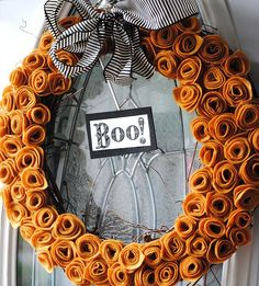 Great DIY Halloween wreath!  Would look nice in white with at white bow for Christmas too.