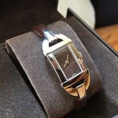 Gucci leather bangle watch! Brand new! Never worn Gucci brown leather bangle watch, silver case in original box with warranty card. Gucci Jewelry Bracelets
