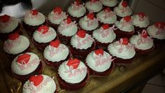"""Red Velvet cupcakes filled with strawberry and White chocolate,  iced with champagne butter cream and topped with sugar lips/heart and a white chocolate """"Love"""" word.  Valentine's Day cupcakes!"""