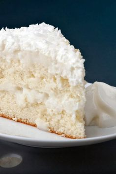 Coconut Cream Cake - An easy cake using a white cake mix, and moistened with a creamy coconut sauce. You may reduce the amount of sauce if you prefer, and it will still be delicious,,