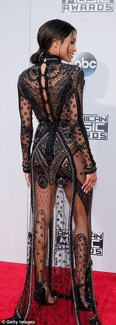 Sheerly stunning: Singer Ciara wore a sheer beaded gown which flashed her toned legs...