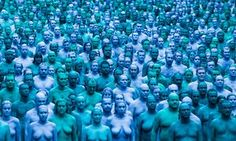 Thousands of people gathered at dawn in Hull to be painted blue and photographed for installation celebrating city's relationship with the sea