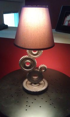The Gear Lamp has an Industrial or Steampunk look to them. The lamp is created from used gears that supplied power thru a transmission gearbox. The