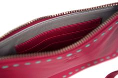 DollyRed Harriet purse in hot pink leather with aqua stitching and silver leather lining.