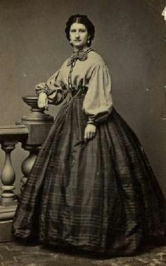 A lady in what appears to be a red Garibaldi blouse