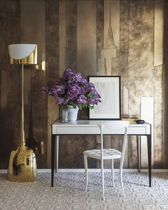 For the sitting area of the master bedroom of an apartment in a Manhattan high-rise, designer Robert Couturier created wall panels from liquid metals and resins in shapes that evoke the city skyline. A desk by Nicolas Aubagnac holds a Tamara de Lempicka drawing, the chair is by Archirivolto and the floor lamp is by Philippe Hiquily.