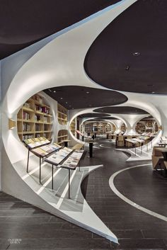 Painted arches dominate the reading room of the Zhongshuge bookstore that X + Living Architectural Design (Shanghai) Co. completed in Yangzhou, China. Photography by Shao . Futuristic Interior, Futuristic Design, Futuristic Architecture, Futuristisches Design, Urban Design, Store Design, Store Interior Design, Interior Design Photography, Design Table