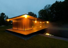 This meditation pavilion features a deck that projects over the pool