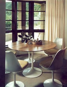 I've posted this table and chairs before...it's a great example of the same piece of furniture having a completely different personality when placed in a different environment!