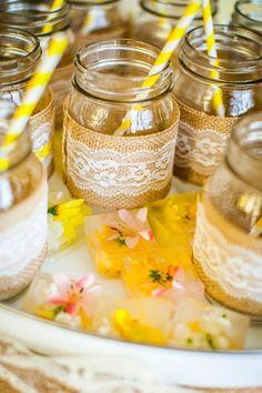 Mason Jar Mimosas in a tray of frozen flower ice cubes www.weheartparties.com