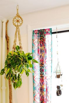 Macrame Hanging Planter and the way that fabric panel is hung.  #urbanoutfitters