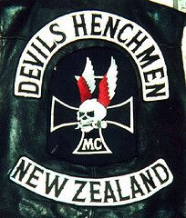 The first outlaw motorcycle clubs, like the well known Hells Angels, were WW2 veterans who decorated their denim and leather jackets with their war trophees like iron crosses, skull badges, swastika's etc. Nowadays a skull or an iron cross logo on a bikers jacket is very common.