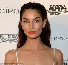 Pout-fection! Make-up artist Patrick Ta applied Anastasia Beverly Hills Liquid Lipstick in Electric Coral ($20, anastasiabeverlyhills.com) to 30-year-old model Lily Aldridge's lips before the Sports Illustrated Swimsuit BBQ
