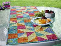 Shining Star Runner by Susan Emory of Swirly Girls Design in Best Fat Quarter Quilts 2014.