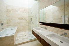 Travertine bathroom with skylight to catch daylight. Beautiful. Architects: RAAD.