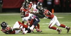 Houston Texans running back Chris Polk (22) is stopped by Atlanta Falcons outside linebacker Nate Stupar (54) and defensive back Robenson Therezie (27) during the third quarter of an NFL football game at the Georgia Dome on Sunday, Oct. 4, 2015, in Atlanta. ( Brett Coomer / Houston Chronicle )