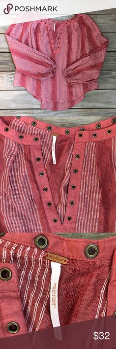 Free People Against All Odds Blouse. Free People Against All Odds Blouse. Grommet details. Long sleeves with elastic at wrist. Striped. 81% rayon 19% cotton. Great condition. Free People Tops