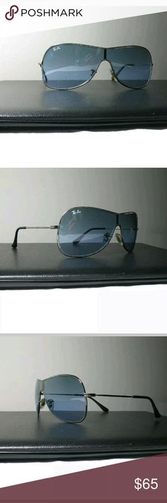 Gently Used RayBan Shield Aviator Sunglasses Gently Used RayBan Shield Aviator Sunglasses with Silver Metal Frames and Blue Gradient Lenses.  This style was discontinued, but the best style ever made by RayBan.  Very sexy shield style and perfect size for a woman's face.  All reasonable offers are considered and appreciated. Ray-Ban Accessories Sunglasses