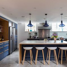 counter stools at kitchen island inspiration :: The Surrey Malthouse is a beautiful example of how incredible a contemporary kitchen design can look with traditional timber touches… Cabinet Door Styles, Cabinet Doors, Kitchen Doors, Kitchen Cabinetry, Cabinet Door Replacement, Contemporary Kitchen Design, Exposed Wood, Bespoke Kitchens, Traditional Kitchen