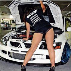 i like the shirt :) Evo 8, Calf Leg, Mitsubishi Lancer Evolution, Car Logos, Car Girls, Jdm, Leather Skirt, Pin Up, Mini Skirts