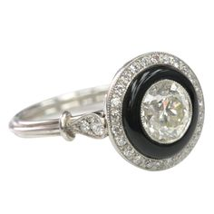 European cut diamond and Onyx engagement ring | From a unique collection of vintage engagement rings at http://www.1stdibs.com/jewelry/rings/engagement-rings/