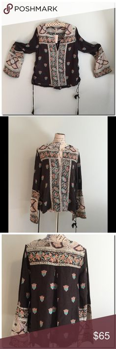 Free People Top Free People tunic top in a vintage-inspired print. Top has subtle bell sleeves and lace up detailing at the sides with an oversized silhouette.   54% Cotton 46% Rayon Hand Wash Cold Import Free People Tops