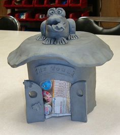 Hand-built toad house using pvc pipe, tar paper and 7in styrofoam salad plate.  Frog topper is two small pinch pots put together.  Example for toad house workshop for kids