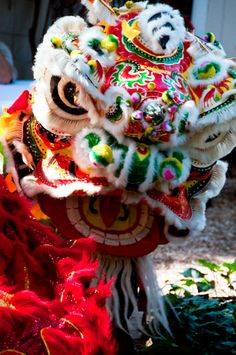 The lion dance is a vigorous form of dance that calls for perfect coordination, elegance and nerves of steel. Two dancers are usually needed to give life to a 'lion' - one to control the movements of the head, eyes and mouth; the other to act as the body. The first dancer that controls the head determines the movements, while the second must work in tandem with him.