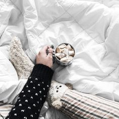 Cozying up with a cup of hot chocolate and marshmallows is one of the simple joys of the holiday season. I'm so excited for Christmas! #whywhiteworks #onthebed