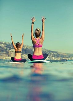 Yoga on surfboard, great to train your mind and body balance I womens inspiration motivation yoga pilates surfboard water training health fitness bayse luxe activewear