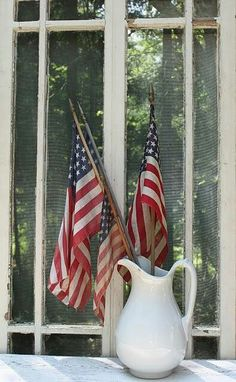 decorating for the 4th doesn't get much easier for chicier than this - toss american flags into a vintage pitcher!