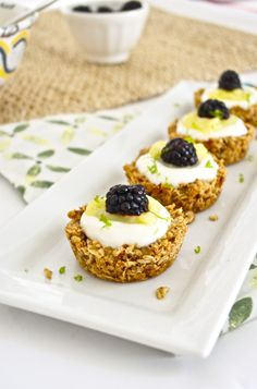 Healthy Snacks - Granola Tart Shells With Greek Yogurt, Lime Curd, and Blackberries. Pretty AND delicious!