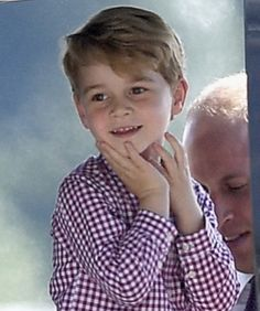 Just LOVE Prince George's cute little pose while touring a helicopter before leaving Germany in 2017.
