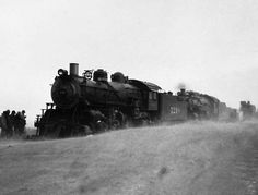 Trainmen in Western Kansas are hoping for relief from a dust storm which made operation of trains difficult. This picture shows a second engine trying to extricate one stalled in a dust drift, April 4, 1935, Dodge City, Ks. (AP Photo) http://www.kansas.com/news/article986206.html#storylink=cpy
