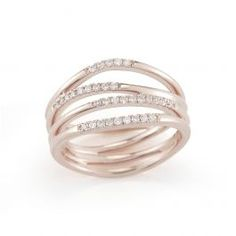 Sparkling with light-catching round white diamonds, this 4 row multi-band rose gold ring is perfect for everyday wear. Designed in an organic shape, the natural movement and architectural interest make this ring a must-have luxurious accent. Impressive as a stand-alone piece, let the intricate design take center stage.