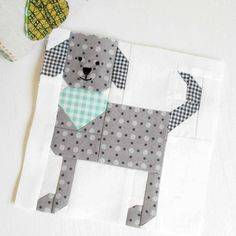 """This little 6"""" puppy is called Elliot and he is the cleanest of pups. #patchsmithbad2017 #spellingbeebook #dogblock #fqsfun #beeinmybonnet #picturedayquilt"""