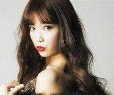 IU releases sexy-concept photos for 2013 Japanese calendar