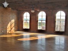 Exposed brick and hardwood floors in an apartment loft